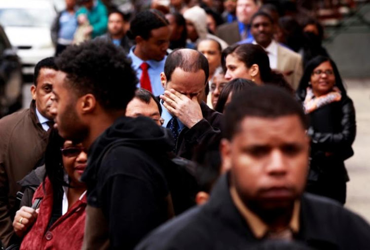 Job seekers wait in line at the Dr. Martin Luther King Jr. career fair held by the New York State department of Labor in New York, US, in this April 12 2012 file photo.  Picture: REUTERS