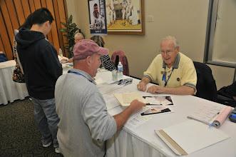 Photo: Astronaut Jim Lovell of Gemini 7, Gemini 12, Apollo 8, and Apollo 13 signing autographs!