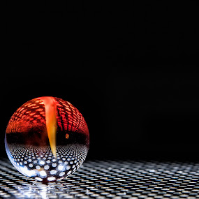 by Nancy Arehart - Artistic Objects Toys ( reflection, marble, red, toy, high contrast,  )
