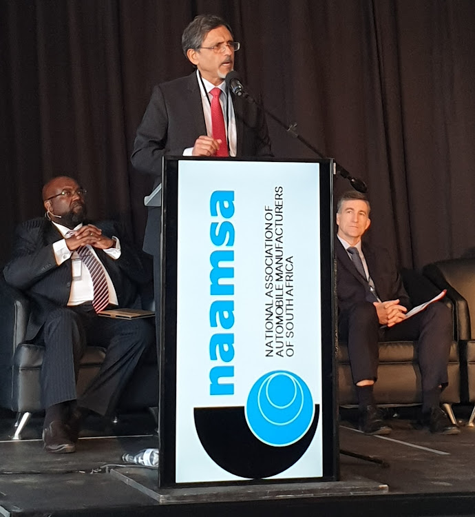 Minister of Trade, Industry and Competition, Ebrahim Patel, addresses delegates at the annual NAAMSA Automotive Conference. Seated behind him are the CEO of NAAMSA, Mike Mabasa (left) and the President of NAAMSA, Andrew Kirby. Picture: SUPPLIED