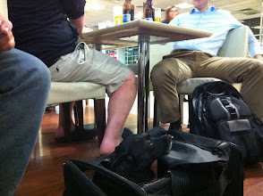 Photo: Malia at a EZE Buenos Aires airport bar with new friends enroute to a visit to Seattle and a long flight.