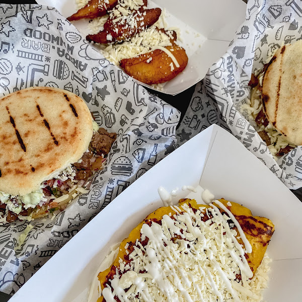 Cheese cachapa (sweet corn arepa), meat lovers arepa and sweet plantains. SO GOOD