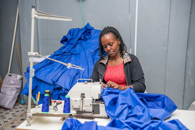 Jennifer Kariithi, one of the small and medium entrepreneurs under the Laikipia Innovation Programme produces the PPEs