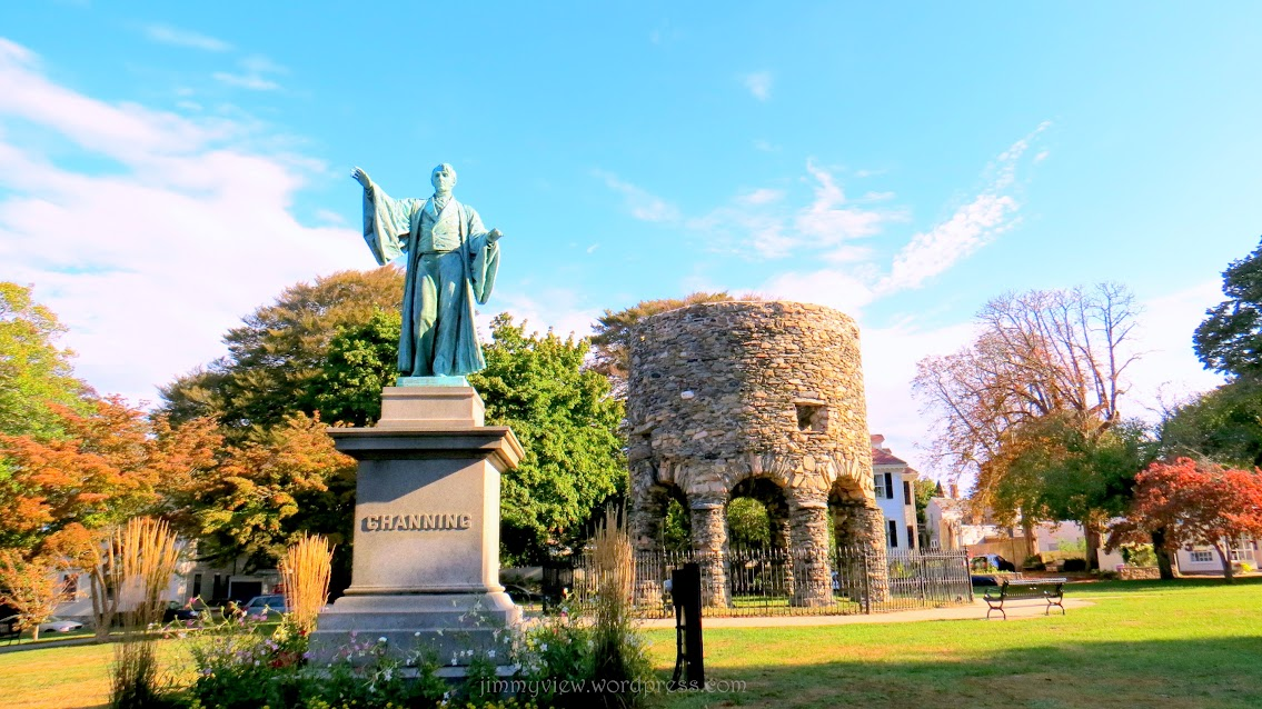 Newport Tower behind a Statue of Channing