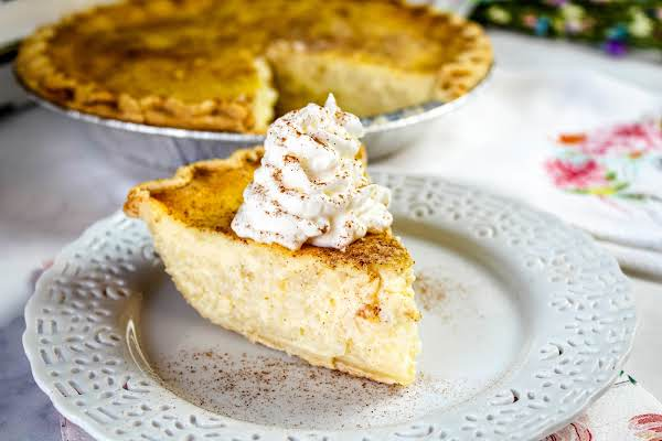 A Slice Of Easter Rice Pie With Whipped Cream.