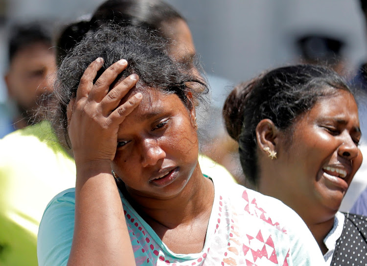 Relatives of victims react at a police mortuary after bomb blasts ripped through churches and luxury hotels on Easter, in Colombo, Sri Lanka, on April 22 2019.