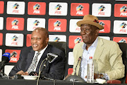 Premier Soccer League (PSL) chairman Irvin Khoza and Police Minister Bheki Cele speak to the media during the PSL and the SA Police Service (SAPS) parnership announcement at the Convention Centre at Emperors Palace, east of Johannesburg on September 06, 2018.