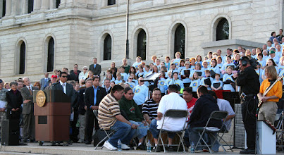 Photo: Native Americans perform percussive music during a ceremony held in front of Capitol Building for Minnesota State's Sesquacentennial.