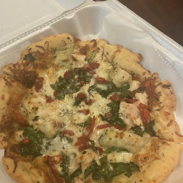Gluten Free pizza with chicken, gorgonzala cheese, tomatoes and artichoke hearts!! Delicious!!