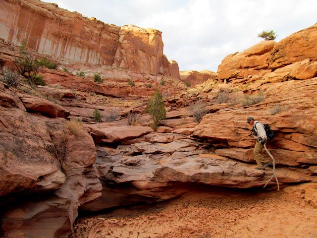 Alan climbing up a dryfall