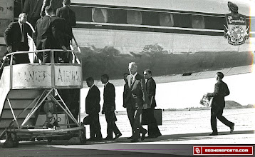 Photo: The team boarding a flight.