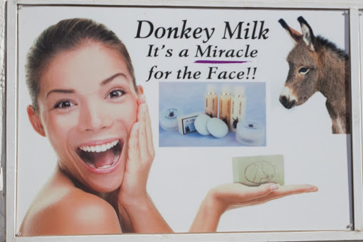Donkey-Milk-billboard.jpg - Really? I didn't know that. A billboard in Oia, Santorini.