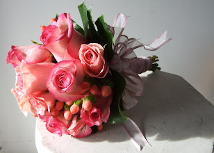 Photo: [B10] Hand tied bouquet with partial stem wrap of pink variegated South American roses and baby pink spray roses with pink hypericum berries