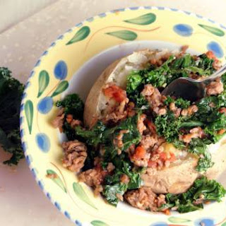 Kale and Sausage Sauté Over Baked Potatoes