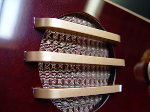 Photo: Vintage gold and maroon grill cloth was used with strips of gold painted Masonite to create the perfect speaker grills.