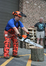 Photo: If you are afraid of the saw, and cutting like this, put it down and quit and get a lesson. You are off balance, and the saw is out of control. [Note: you would never cut a log on end-grain orientation like this; Matt is just using it as a prop at this point.]