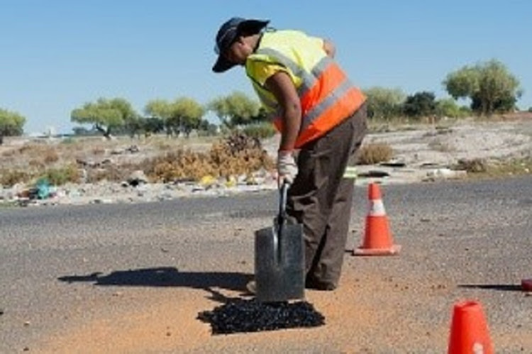 A City of Cape Town worker repairs a pothole. Image: City of Cape Town
