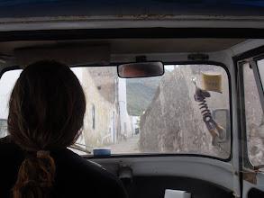 Photo: Dans le triporteur à la recherche d'un logement