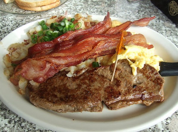 "A man's ""Breakfast in Bed""; at least my man anyway. LOLSteak, bacon, sausage, large..."