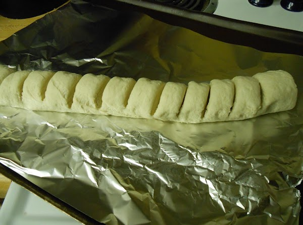 Place bread dough, seam side down, on foil-lined cookie sheet.