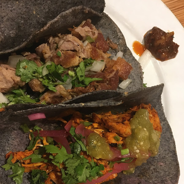 Pork taco and chicken taco with salsa verde
