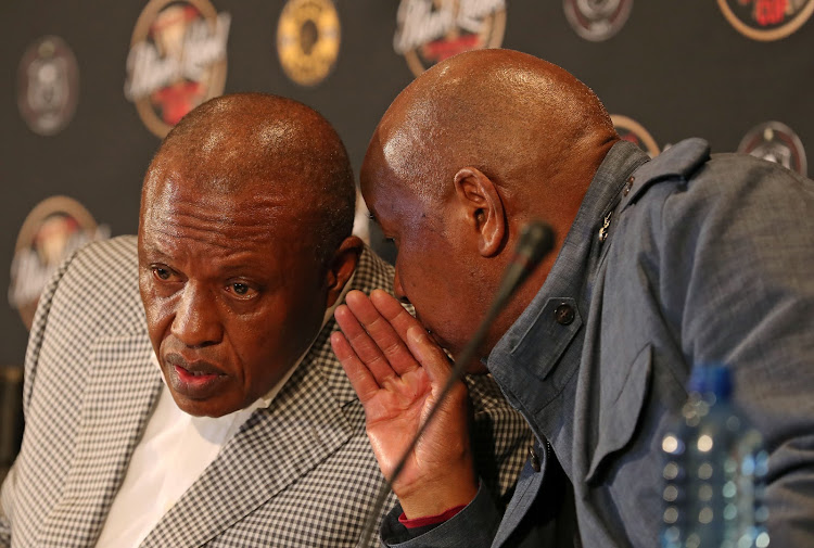 A file photo of Premier Soccer League and Orlando Pirates chairman Irvin Khoza with the chairman of Kaizer Chiefs Kaizer Motaung at a press conference. The Premier Soccer League has been criticized for its alleged lucklustre planning for the Ellis Park disaster which claimed the lives of 43 fans and injured more than 150 more at a packed Ellis Park Stadium in 2001.