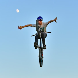 I Believe I Can Fly ! by Marco Bertamé - Sports & Fitness Other Sports ( flying, moon, sky, blue, air, arms, high, dow, helmet, stunt, bicycle, jump )
