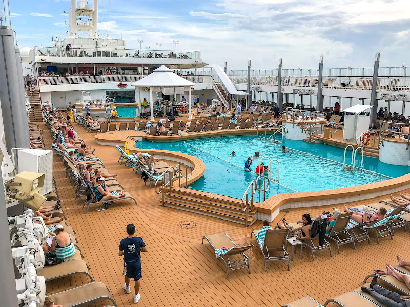The main pool deck on a sunny day during a cruise on Norwegian Jade.
