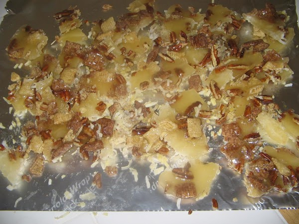 Remove from heat and spoon or pour in a thin stream ,evenly over pecans,...
