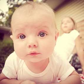 Baby Boy with Sister in Background by Jess Anderson - Babies & Children Children Candids ( little boy, infant, outdoor, blue eyes, baby )