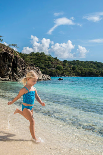 A girl frolics on the beach on St. John, U.S. Virgin Islands.