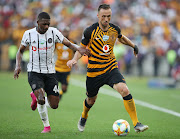 Samir Nurkovic is chased for the ball by Abel Mabaso during the Telkom Knockout Soweto derby in Durban.