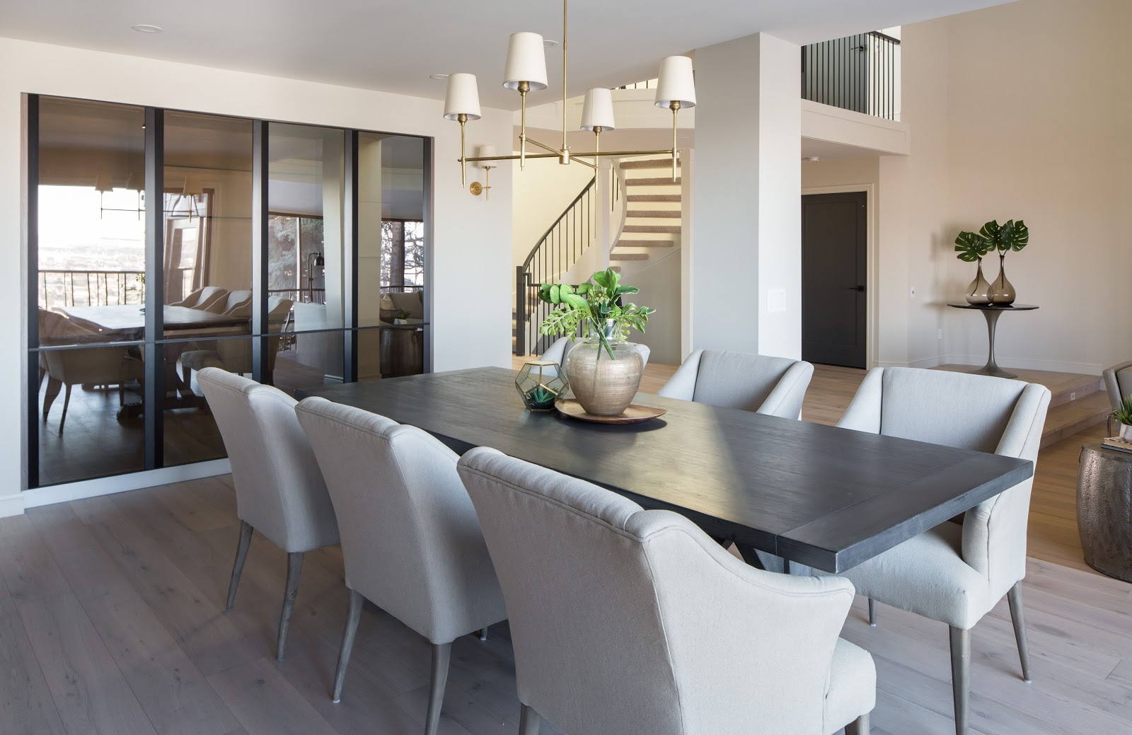 elegant comfortable dining table and chairs with modern traditional lighting in calgary foothills