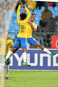 Percy Tau celebrates with goalscorer Themba Zwane    in   Sundowns'   win against Wits at Loftus Versfeld Stadium at the weekend.