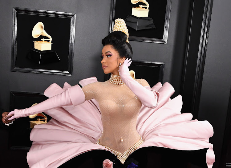 Cardi B wore a dramatic vintage Thierry Mugler couture gown on the red carpet at the 2019 Grammy Awards.