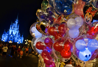 Photo: Balloons at Disney  Do you know these balloons cost $10?  TEN DOLLARS!  A ten dollar balloon...  but they do light up.  So that's kinda cool.  What isn't cool is that you have to buy one for every single kid in your retinue.  One other cool thing (kinda secret) is that if it ever goes flat or pops, you can bring it back to get a free one.  Technically, you could even bring it back the next year and still get a new one.  This might go against the spirit of the deal, but it is a ten dollar balloon for the love of Disney-god.  From Trey Ratcliff's travel photography blog, Stuck in Customs.