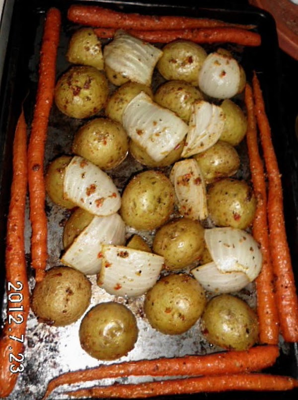 Cut heads off of carrots and wash well.  Slice potatoes in half, and...
