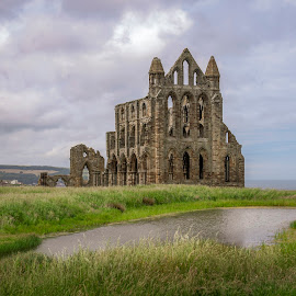 Remains by Darrell Evans - Buildings & Architecture Public & Historical ( sky, green, yorkshire, old, whitby, augustinian, remains, whitby abbey, clouds, water, building, stone, outdoor, abbey, monastery, grass, augustinian monastery, priory, landscape )