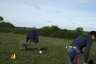 Photo: DogBasics Fun Day 2013 - Paul taking out his step in the leg weaving part of The Crazies game...