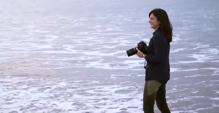 lady taking photos at ocean