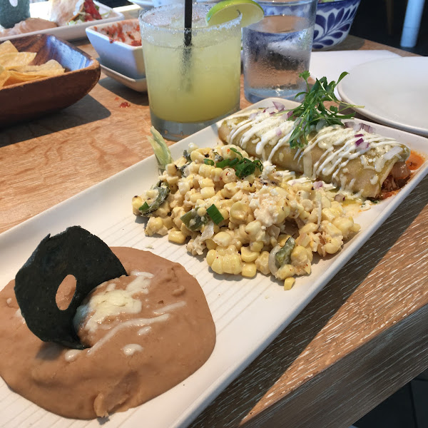 Chicken enchilada with street corn and refried beans and a cucumber margarita with Don Julio subbed. So good.
