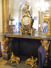 Photo: The room's elegant fireplace is supported by two yellow marble sphinxes.