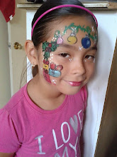 Photo: Christmas face painting by Bella the Clown. Call to book Bella today at 888-750-7024