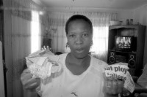CONNED: Dimakatso Tlholo of Green Village in Soweto was defrauded of R12 000. Pic. Pat Seboko. 22/04/2007. © Sowetan.