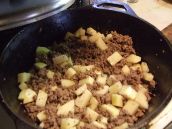 Fry beef in a medium-sized saucepan at medium heat until browned. Add potatoes and...