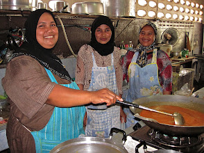 Photo: three women making curry sauce, Takua Pa roti shop
