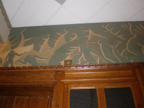 Photo: Part of the mural along the top of the meeting room by Aaron Douglas. This scene shows the hunting and praising of blacks in Africa.