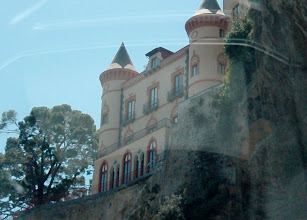 Photo: A castle on a cliff (photo through the front windshield, rounding a hairpin turn)