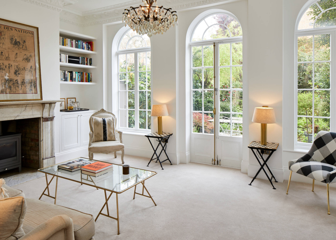 Living room in a period property showcasing large curved french windows in a West London family home.