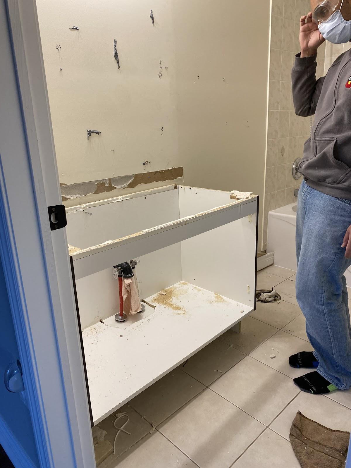 Bathroom demo for beginners includes removing toilet, vanity, mirror